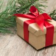 Beige gift box with red ribbon — Stock Photo