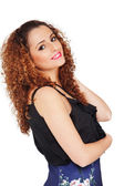 Attractive curly girl smiling — Stock fotografie