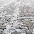 Snow on the cobblestones, soft focus — Stock Photo