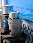 Cooking in village using old equipment — Stock Photo
