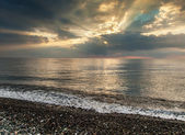 Dramatic clouds and the sea shore — Stock Photo