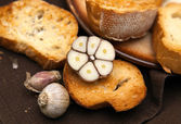 Slice of grilled baguette and garlic — Stock Photo