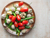 Chilli peppers, cherry tomatoes and garlic — Stock Photo