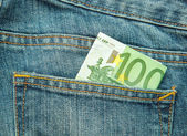 100 euro in the pocket of jeans — Stock Photo
