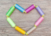 Spools of thread in the shape of heart — Stock Photo