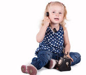 Curly-haired little girl with a vintage telephone — Stock Photo