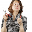 Young woman with a pair of pliers and a screwdriver — Stock Photo #39764687