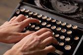 Human hand prints on retro typewriter. — Stock Photo