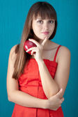 Beautiful young woman with a red apple — Photo
