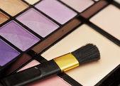 Set for make-up. Eyeshadow, powder, brushes. — Stock Photo