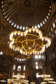 Vintage lamps in the cathedral of Hagia Sophia in Istanbul, Turk — Stock Photo