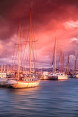 Old boat on the sea in the port at sunset — Foto Stock