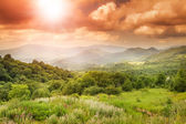 Bright stunning beautiful sunset in the mountain valley — Stock Photo