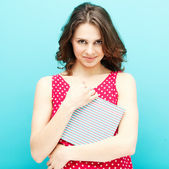 Beautiful girl in a red polka dot blouse with a diary  — Stock Photo