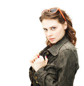 Beautiful young woman in a denim jacket with sun glasses isolate — Zdjęcie stockowe