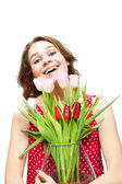 Young beautiful woman with a vase of flowers, isolated on white  — Stock Photo