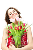 Young beautiful woman with a vase of flowers, isolated on white  — Foto de Stock