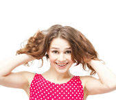 Young beautiful woman in red blouse holding his head, smiling, i — Stock Photo