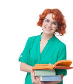 Red-haired girl in glasses with books — Stockfoto