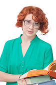 Red-haired girl in glasses with books — Stock Photo