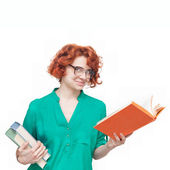 Red-haired girl in glasses with books — Stok fotoğraf