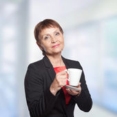 Attractive woman 50 years with cup of  coffee — Stok fotoğraf