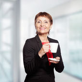 Attractive woman 50 years with cup of  coffee — Stock Photo
