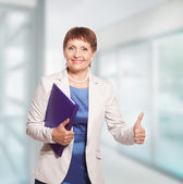 Attractive woman 50 years old with a folder for documents — Stok fotoğraf