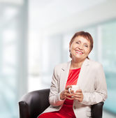 Attractive woman 50 years old with cup of  coffee — Stock Photo