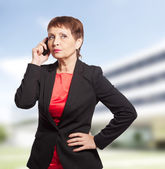 Attractive woman 50 years old with a mobile phone — Stock Photo