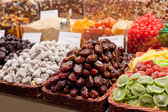Counter with a variety of nuts and dried fruit — Stockfoto