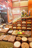 Counter with a variety of nuts, spices and dried fruit — Stockfoto