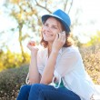 Beautiful girl speaks on mobile phone in park — Stock Photo #48027719
