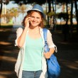 Beautiful girl speaks on mobile phone — Stock Photo #48027749