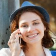 Beautiful girl speaks on mobile phone — Stock Photo #48027751