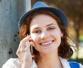 Beautiful girl speaks on mobile phone — Stock Photo