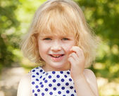 Funny little girl 3 years outdoors — Stock Photo