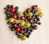 Berries of black currant, cherry and gooseberry in the form of h — Photo