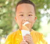 Asian boy eating ice cream in summer — Stock Photo