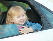 Cute little girl 3 years old, in the car  — Stockfoto