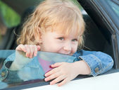 Cute little girl 3 years old, in the car  — Stock Photo
