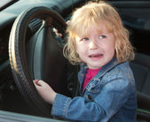 Upset little girl crying in the car, in soft focus — Stock Photo