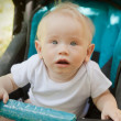 Year-old child in a stroller, in soft focus — Stock Photo #49919843