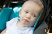 Year-old child in a stroller, in soft focus — Photo