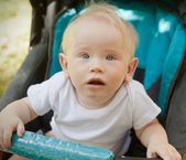 Year-old child in a stroller, in soft focus — Stock Photo