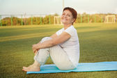Attractive woman 50 years doing fitness — Stock Photo