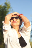Attractive woman 50 years in sunglasses — Stock Photo