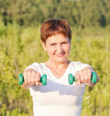 Attractive woman 50 years doing fitness — Foto Stock
