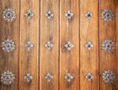 Vintage wooden door, medieval architecture. Part of a door of ol — Stock Photo