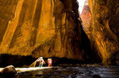 Two hikers in a sunbeam at Wall Street in Zion Canyon at Zion Na — Stock Photo